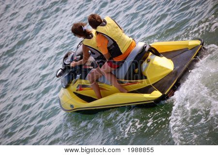 Two Girls On A Yellow Jetski