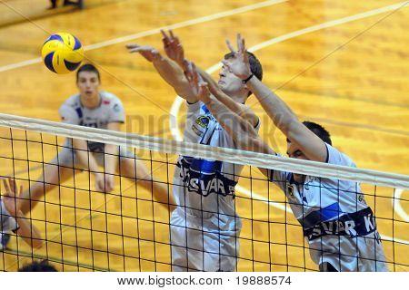 KAPOSVAR, HUNGARY - OCTOBER 1: Krisztian Csoma (C) blocks the ball at a Middle European League volleyball game Kaposvar (HUN) vs Posojilnica (AUT), October 1, 2010 in Kaposvar, Hungary