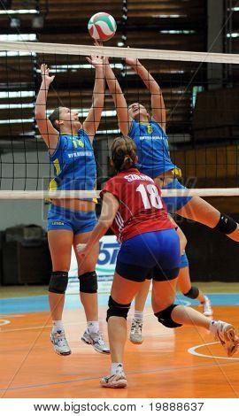 KAPOSVAR, HUNGARY - OCTOBER 3: Ihasz (14) and Balajcza (8) blocks the ball at the Hungarian NB I. League woman volleyball game Kaposvar vs Szolnok, October 3, 2010 in Kaposvar, Hungary.