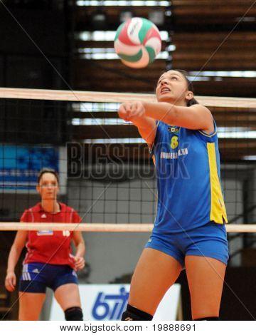 KAPOSVAR, HUNGARY - OCTOBER 3: Barbara Balajcza receives the ball at the Hungarian NB I. League woman volleyball game Kaposvar vs Szolnok, October 3, 2010 in Kaposvar, Hungary.