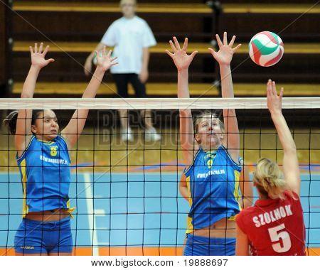 KAPOSVAR, HUNGARY - OCTOBER 3: Balajcza (8) and Rak (9) in action at the Hungarian NB I. League woman volleyball game Kaposvar vs Szolnok, October 3, 2010 in Kaposvar, Hungary.