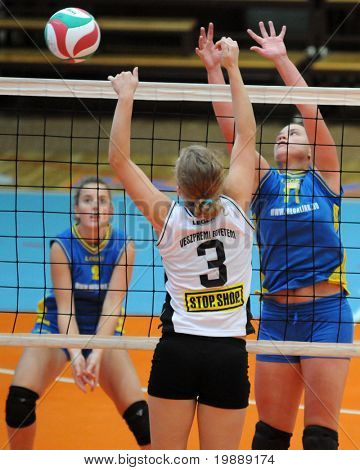 KAPOSVAR, HUNGARY - OCTOBER 10: Marianna Palfy (R) blocks the ball at the Hungarian NB I. League woman volleyball game Kaposvar vs Veszprem, October 10, 2010 in Kaposvar, Hungary.