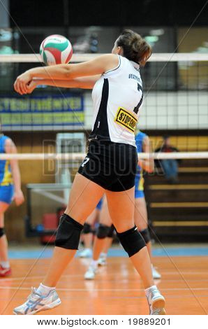 KAPOSVAR, HUNGARY - OCTOBER 10: Nora Foldesi receives the ball at the Hungarian NB I. League woman volleyball game Kaposvar vs Veszprem, October 10, 2010 in Kaposvar, Hungary.