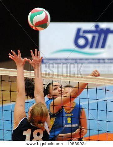 KAPOSVAR, HUNGARY - OCTOBER 31: Barbara Balajcza (R) strikes the ball at the Hungarian NB I. League woman volleyball game Kaposvar vs Ujbuda, October 31, 2010 in Kaposvar, Hungary.