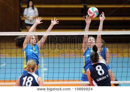 KAPOSVAR, HUNGARY - OCTOBER 31: Rebeka Rak (9) blocks the ball at the Hungarian NB I. League woman volleyball game Kaposvar vs Ujbuda, October 31, 2010 in Kaposvar, Hungary.