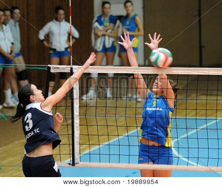 KAPOSVAR, HUNGARY - OCTOBER 31: Zsanett Pinter (R) blocks the ball at the Hungarian NB I. League woman volleyball game Kaposvar vs Ujbuda, October 31, 2010 in Kaposvar, Hungary.