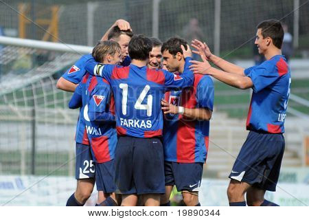 KAPOSVAR, HUNGARY - NOVEMBER 6: Videoton players celebrate a goal at a Hungarian National Championship soccer game Kaposvar vs Videoton November 6, 2010 in Kaposvar, Hungary.
