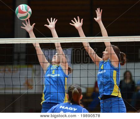 KAPOSVAR, HUNGARY - NOVEMBER 14: Zsanett Pinter (L) in action at the Hungarian NB I. League woman volleyball game Kaposvar vs Miskolc on November 14, 2010 in Kaposvar, Hungary.