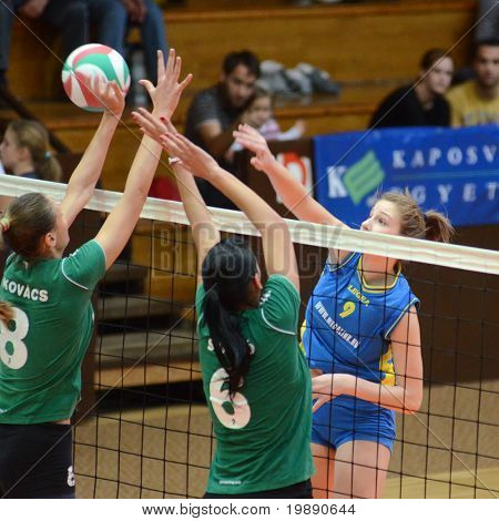 KAPOSVAR, HUNGARY - NOVEMBER 14: Rebeka Rak (R) in action at the Hungarian NB I. League woman volleyball game Kaposvar vs Miskolc on November 14, 2010 in Kaposvar, Hungary.