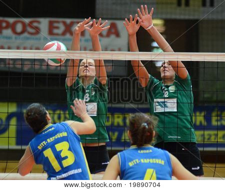 KAPOSVAR, HUNGARY - NOVEMBER 14: Gabriella Kondor (13) strikes the ball at the Hungarian NB I. League woman volleyball game Kaposvar vs Miskolc on November 14, 2010 in Kaposvar, Hungary.