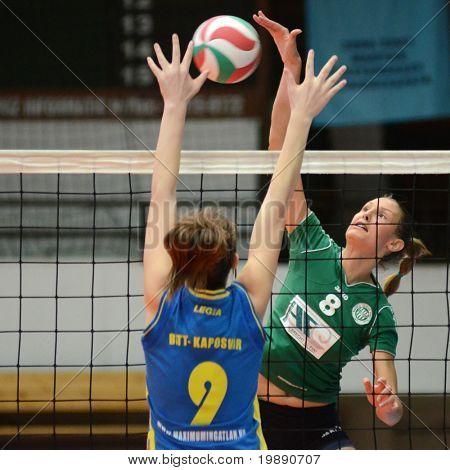 KAPOSVAR, HUNGARY - NOVEMBER 14: Rebeka Rak (L) blocks the ball at the Hungarian NB I. League woman volleyball game Kaposvar vs Miskolc on November 14, 2010 in Kaposvar, Hungary.