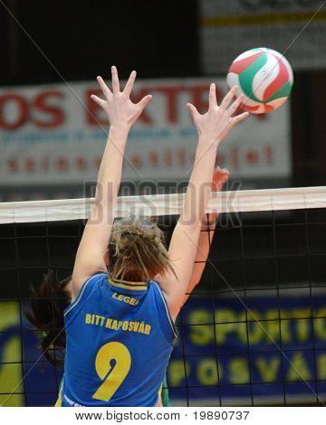 KAPOSVAR, HUNGARY - NOVEMBER 14: Rebeka Rak blocks the ball at the Hungarian NB I. League woman volleyball game Kaposvar vs Miskolc on November 14, 2010 in Kaposvar, Hungary.