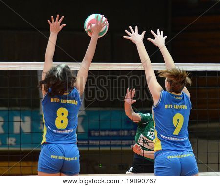 KAPOSVAR, HUNGARY - NOVEMBER 14: Barbara Balajcza (L) blocks the ball at the Hungarian NB I. League woman volleyball game Kaposvar vs Miskolc on November 14, 2010 in Kaposvar, Hungary.