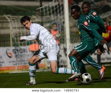 KAPOSVAR, HUNGARY - NOVEMBER 19: Robert Szepessy (in white) in action at a Hungarian National Championship soccer game Kaposvar vs Gyori ETO November 19, 2010 in Kaposvar, Hungary.