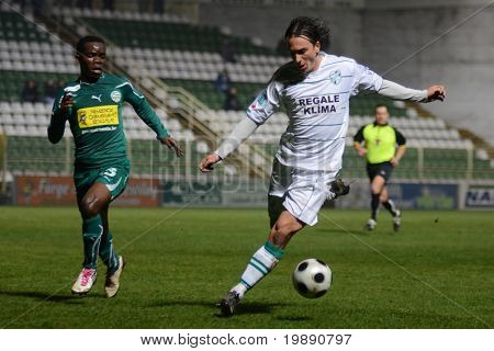 KAPOSVAR, HUNGARY - NOVEMBER 19: Lorant Olah (in white) in action at a Hungarian National Championship soccer game Kaposvar vs Gyori ETO November 19, 2010 in Kaposvar, Hungary.