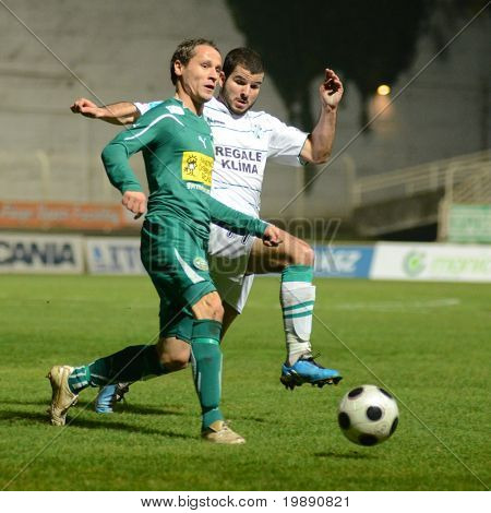 KAPOSVAR, HUNGARY - NOVEMBER 19: Pedro Sass (in white) in action at a Hungarian National Championship soccer game Kaposvar vs Gyori ETO November 19, 2010 in Kaposvar, Hungary.