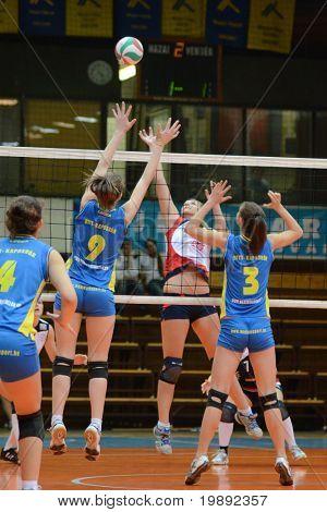 KAPOSVAR, HUNGARY - DECEMBER 12: Rebeka Rak (9) in action at the Hungarian NB I. League woman volleyball game Kaposvar vs Eger on December 12, 2010 in Kaposvar, Hungary.