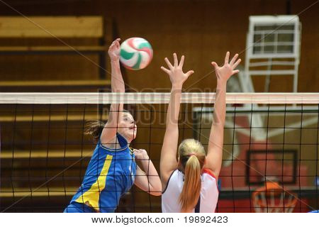 KAPOSVAR, HUNGARY - DECEMBER 12: Zsanett Pinter (L) in action at the Hungarian NB I. League woman volleyball game Kaposvar vs Eger on December 12, 2010 in Kaposvar, Hungary.