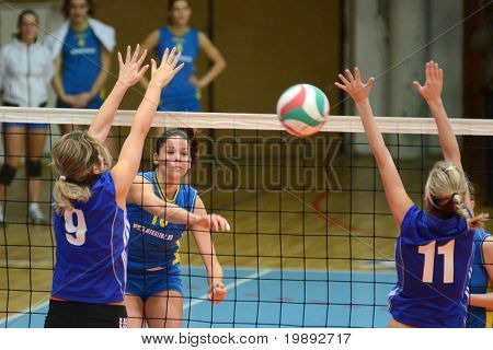 KAPOSVAR, HUNGARY - DECEMBER 19: Szandra Szombathelyi (C) in action at the Hungarian NB I. League woman volleyball game Kaposvar vs Palota Bollhoff on December 19, 2010 in Kaposvar, Hungary.