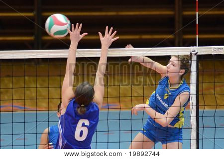 KAPOSVAR, HUNGARY - DECEMBER 19: Rebeka Rak (R) in action at the Hungarian NB I. League woman volleyball game Kaposvar vs Palota Bollhoff on December 19, 2010 in Kaposvar, Hungary.