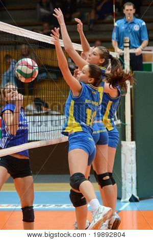 KAPOSVAR, HUNGARY - DECEMBER 19: Szandra Szombathelyi (2nd from L) in action at the Hungarian NB I. League woman volleyball game Kaposvar vs Palota Bollhoff on December 19, 2010 in Kaposvar, Hungary.