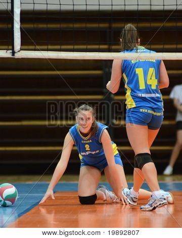 KAPOSVAR, HUNGARY - DECEMBER 19: Zsanett Pinter (L) in action at the Hungarian NB I. League woman volleyball game Kaposvar vs Palota Bollhoff on December 19, 2010 in Kaposvar, Hungary.