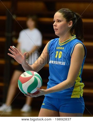 KAPOSVAR, HUNGARY - DECEMBER 19: Szandra Szombathelyi serves the ball at the Hungarian NB I. League woman volleyball game Kaposvar vs Palota Bollhoff on December 19, 2010 in Kaposvar, Hungary.