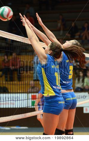 KAPOSVAR, HUNGARY - DECEMBER 19: Szandra Szombathelyi (L) blocks the ball at the Hungarian NB I. League woman volleyball game Kaposvar vs Palota Bollhoff on December 19, 2010 in Kaposvar, Hungary.