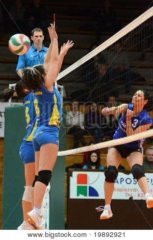 KAPOSVAR, HUNGARY - DECEMBER 19: Barbara Balajcza (C) blocks the ball at the Hungarian NB I. League woman volleyball game Kaposvar vs Palota Bollhoff on December 19, 2010 in Kaposvar, Hungary.