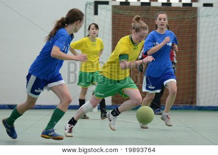 SZENNA, HUNGARY - JANUARY 15: Unidentified players in action at a Somogy Sporja Girl Futsal Competition match between Fonyod and Kaposvar University January 15, 2011 in Szenna, Hungary.