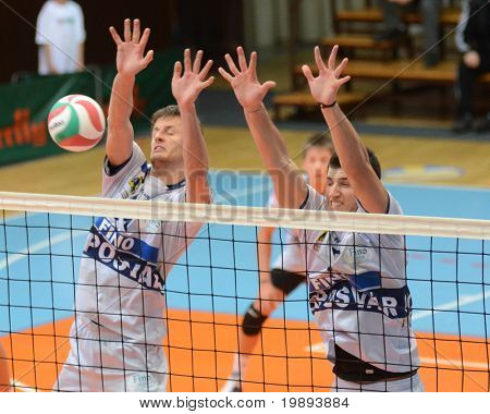 KAPOSVAR, HUNGARY - JANUARY 17: Krisztian Csoma (L) blocks the ball at a Hungarian volleyball National Championship game (Kaposvar vs Dunaferr), on January 17, 2011 in Kaposvar, Hungary.