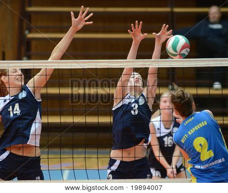 KAPOSVAR, HUNGARY - JANUARY 14: Zsanett Pinter (2) strikes the ball at the Hungarian NB I. League woman volleyball game Kaposvar vs Ujbuda, January 14, 2011 in Kaposvar, Hungary.
