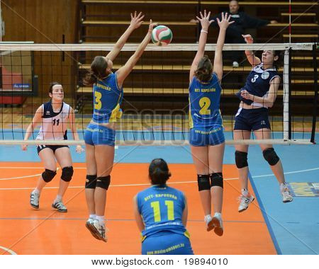 KAPOSVAR, HUNGARY - JANUARY 14: Zsanett Pinter (2) blocks the ball at the Hungarian NB I. League woman volleyball game Kaposvar vs Ujbuda, January 14, 2011 in Kaposvar, Hungary.