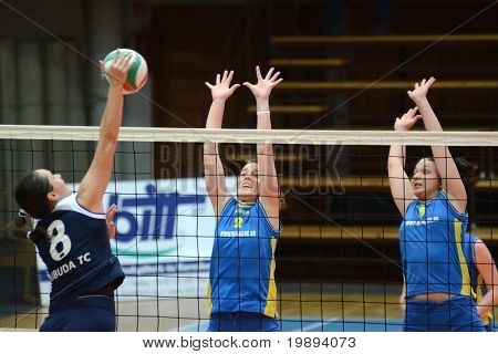 KAPOSVAR, HUNGARY - JANUARY 14: Zsanett Pinter (C) blocks the ball at the Hungarian NB I. League woman volleyball game Kaposvar vs Ujbuda, January 14, 2011 in Kaposvar, Hungary.