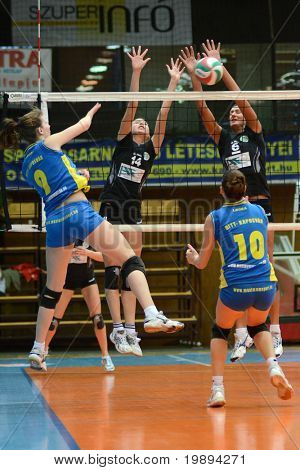 KAPOSVAR, HUNGARY - JANUARY 23: Rebeka Rak (9) strikes the ball at the Hungarian NB I. League woman volleyball game Kaposvar vs Miskolc, January 23, 2011 in Kaposvar, Hungary.