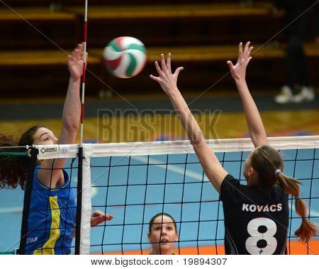 KAPOSVAR, HUNGARY - JANUARY 23: Petra Horvath (L) strikes the ball at the Hungarian NB I. League woman volleyball game Kaposvar vs Miskolc, January 23, 2011 in Kaposvar, Hungary.