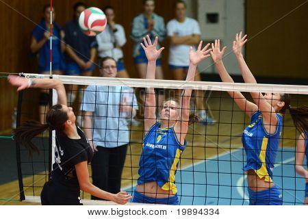 KAPOSVAR, HUNGARY - JANUARY 23: Rebeka Rak (9) blocks the ball at the Hungarian NB I. League woman volleyball game Kaposvar vs Miskolc, January 23, 2011 in Kaposvar, Hungary.