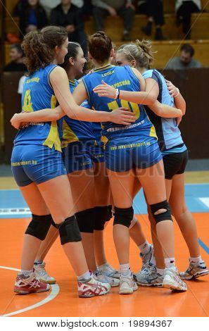 KAPOSVAR, HUNGARY - JANUARY 23: Kaposvar players celebrate at the Hungarian NB I. League woman volleyball game Kaposvar vs Miskolc, January 23, 2011 in Kaposvar, Hungary.