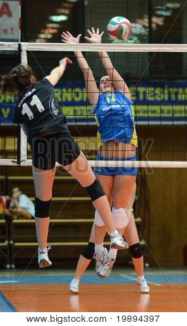 KAPOSVAR, HUNGARY - JANUARY 23: Dora Ihasz (R) blocks the ball at the Hungarian NB I. League woman volleyball game Kaposvar vs Miskolc, January 23, 2011 in Kaposvar, Hungary.