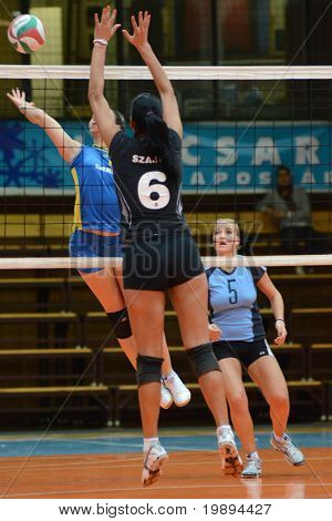 KAPOSVAR, HUNGARY - JANUARY 23: Barbara Balajcza (L) strikes the ball at the Hungarian NB I. League woman volleyball game Kaposvar vs Miskolc, January 23, 2011 in Kaposvar, Hungary.