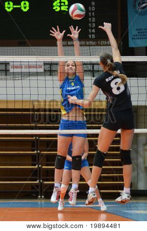 KAPOSVAR, HUNGARY - JANUARY 23: Petra Horvath (L) blocks the ball at the Hungarian NB I. League woman volleyball game Kaposvar vs Miskolc, January 23, 2011 in Kaposvar, Hungary.
