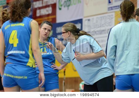 KAPOSVAR, HUNGARY - JANUARY 23: Marta Halasz (Kaposvar trainer) (2nd from R) at the Hungarian NB I. League woman volleyball game Kaposvar vs Miskolc, January 23, 2011 in Kaposvar, Hungary.