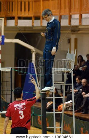 KAPOSVAR, HUNGARY - JANUARY 28: Ivanisevic complains to the referee at a Middle European League volleyball game Kaposvar (HUN) vs. Mladost Zagreb (CRO), January 28, 2011 in Kaposvar, Hungary.