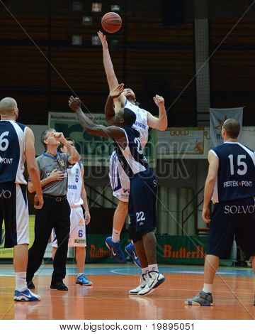 KAPOSVAR, HUNGARY - JANUARY 26: Kurt Cunningham (in the top) in action at a Hugarian Cup basketball game Kaposvar vs. Szeged January 26, 2011 in Kaposvar, Hungary.