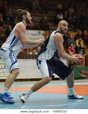 KAPOSVAR, HUNGARY - JANUARY 26: Kurt Cunningham (L) in action at a Hugarian Cup basketball game Kaposvar vs. Szeged January 26, 2011 in Kaposvar, Hungary.
