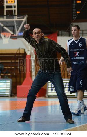 KAPOSVAR, HUNGARY - JANUARY 26: Adam Fekete (L) (Kaposvar trainer) in action at a Hugarian Cup basketball game Kaposvar vs. Szeged January 26, 2011 in Kaposvar, Hungary.