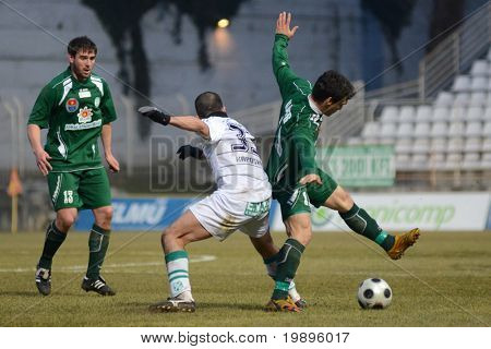 KAPOSVAR, HUNGARY - FEBRUARY 16: Pedro Sass Pedrazzi (C) in action at a Hungarian National Cup soccer game Kaposvar vs Paks February 16, 2011 in Kaposvar, Hungary.