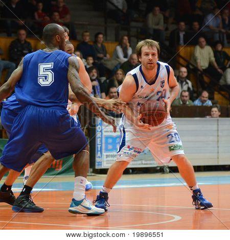 KAPOSVAR, HUNGARY - FEBRUARY 26: Joshua Wilson (R) in action at a Hungarian National Championship basketball game Kaposvar vs Albacomp on February 26, 2011 in Kaposvar.