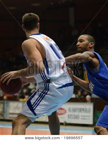 KAPOSVAR, HUNGARY - FEBRUARY 26: Daniel Werner (L) in action at a Hungarian National Championship basketball game Kaposvar vs Albacomp on February 26, 2011 in Kaposvar.