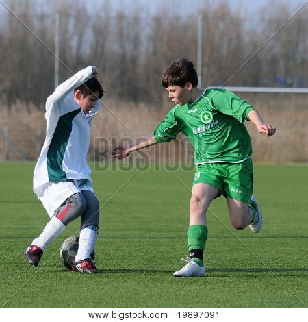 KAPOSVAR, HUNGARY - MARCH 9: Soma Ozorai (L) in action at the Hungarian National Championship under 13 game between Kaposvar and Airnergy FC on March 9, 2011 in Kaposvar, Hungary.